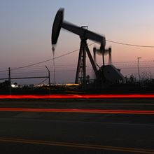 Oil drops further below $56 on report of U.S. inventory rise