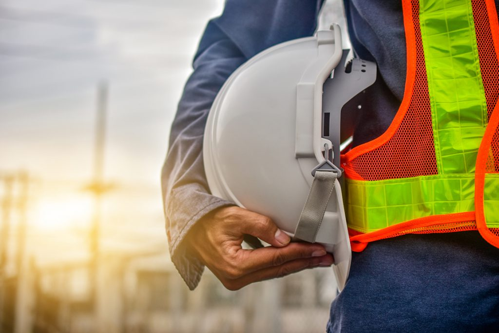 Engineer holding hard hat  construction  worker  professional  safety  work  industry  building person  manager service